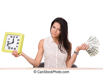 Businesswoman sitting at the table with money and clock