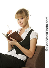 Businesswoman sitting in chair with notepad