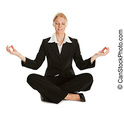 Businesswoman sitting in lotus flower position