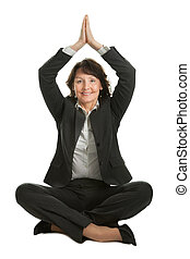 Businesswoman sitting in lotus position