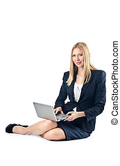Businesswoman sitting on floor with laptop