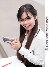 Businesswoman Sitting using a smartphone.