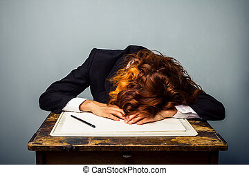 Businesswoman sleeping at drawing board