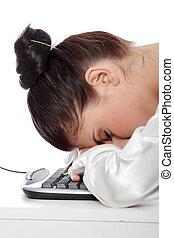 Businesswoman sleeping on the keyboard