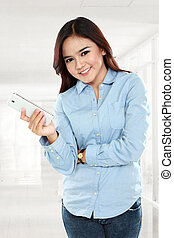 Businesswoman smiling and holding cellphone