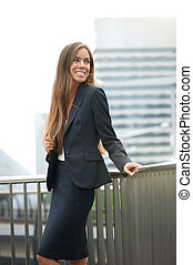 Businesswoman smiling in the city
