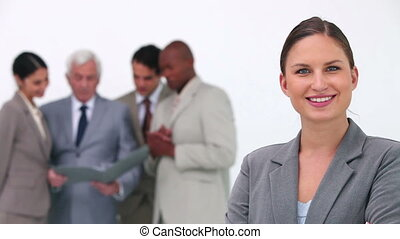 Businesswoman smiling in the  foreground