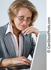 Businesswoman smiling into camera