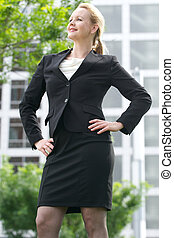 Businesswoman smiling outdoors in the city