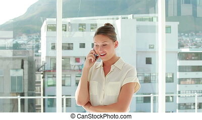 Businesswoman smiling while phoning
