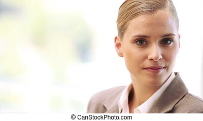 Businesswoman smiling while standing upright