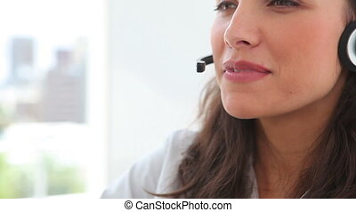 Businesswoman smiling while talking on a headset