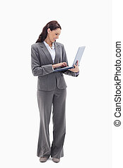Businesswoman smiling while watching her laptop
