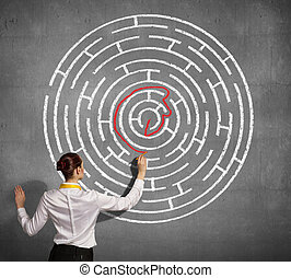 Businesswoman solving maze problem - Back view image of ...