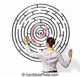 Businesswoman solving maze problem - Back view image of...