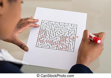 Businesswoman Solving Maze Puzzle