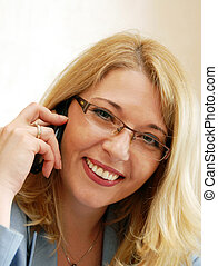 Businesswoman speaking by mobile phone