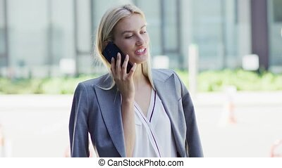 Businesswoman speaking on phone on street