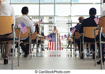 Businesswoman speaking to business people in conference room during meeting