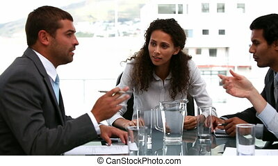 Businesswoman speaking with team during a meeting n the...