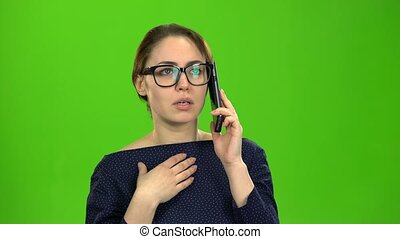 Businesswoman speaks on the phone and is angry with the...