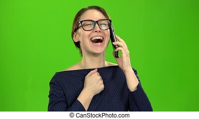 Businesswoman speaks on the phone and smile . Green screen -...