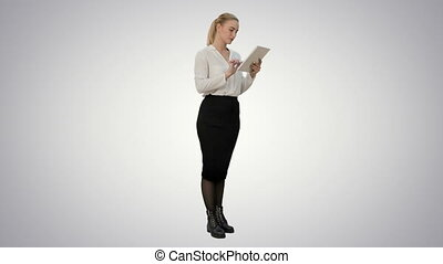 Businesswoman standin with digital tablet and working on white background.