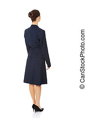 Businesswoman standing back
