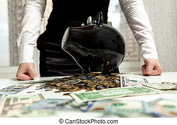 businesswoman standing behind piggy bank on pile of money