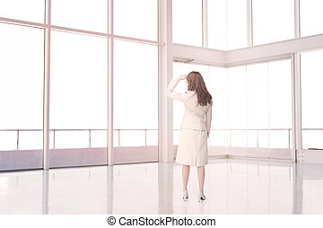 Businesswoman standing in an empty room