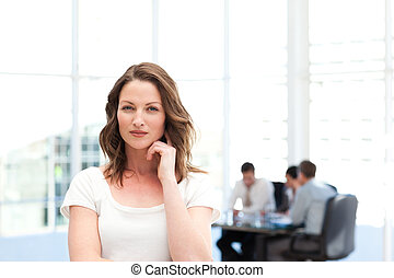 Businesswoman standing in an office