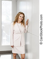 Businesswoman standing in hallway