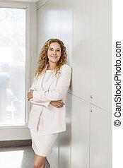 Businesswoman standing in hallway