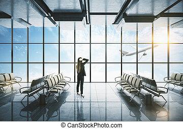 Businesswoman standing in modern airport