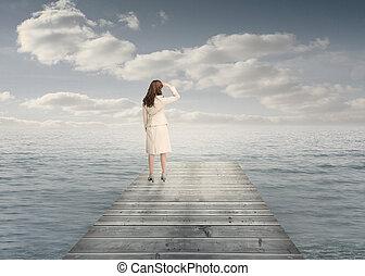 Businesswoman standing on a bridge