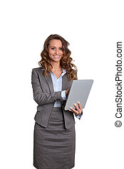 Businesswoman standing on white background with touchpad