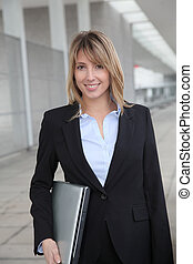 Businesswoman standing outside a building