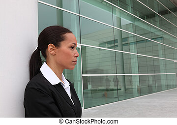 Businesswoman standing outside an office building