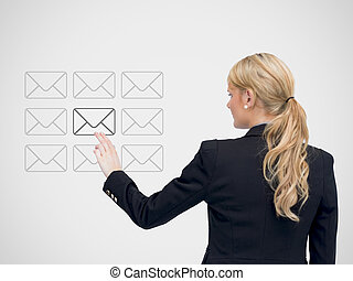 Businesswoman standing touching a message symbol