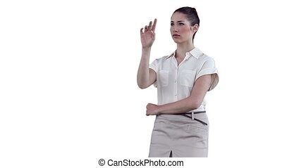 Businesswoman standing while interacting with a virtual touchscreen