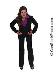 Businesswoman standing with her hands on her hips