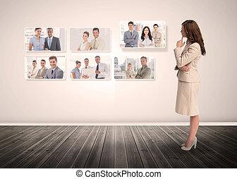 Businesswoman staring at digital