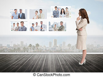 Businesswoman staring at futuristic interface