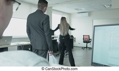 Businesswoman started to dance in the office. In dance, a...