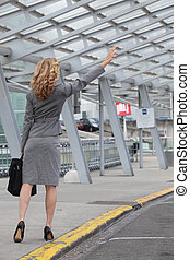 Businesswoman stopping taxi