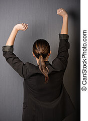 Businesswoman stretching her arms - Businesswoman standing...