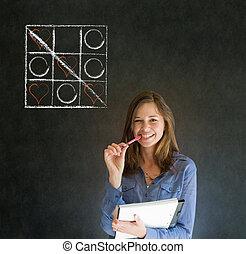 Businesswoman, student or teacher tic tac toe love valentine concpet on blackboard background
