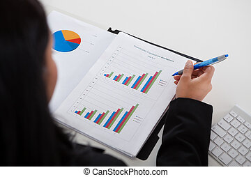 Businesswoman Studying Graph