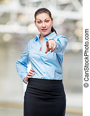 Businesswoman successful and young posing against in office