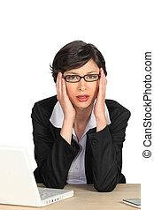 Businesswoman suffering from a headache